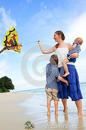 Free Family Flying Kite On Tropical Beach Royalty Free Stock Photo - 15698935