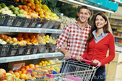 Family at food shopping in supermarket