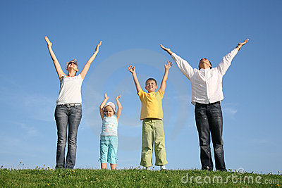 Family Of Four On Grass Stock Image - Image: 2508291