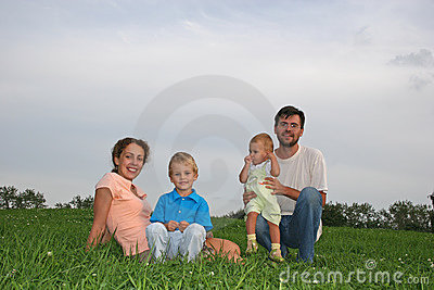 Family four on meadow