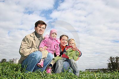 Family of four sit