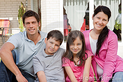 Family of four sitting together - Outdoors