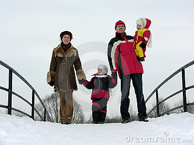 Family of four on winter bridge