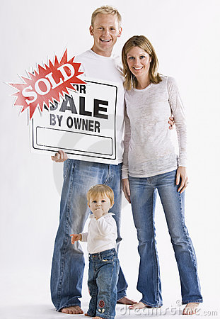 Family in Front of Sign