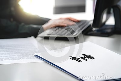 Family future, health care or finance planning concept. Woman writing insurance or mortgage application with computer. Stock Photo