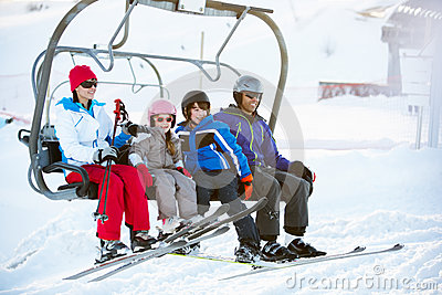 Family Getting Off Chair Lift On Holiday