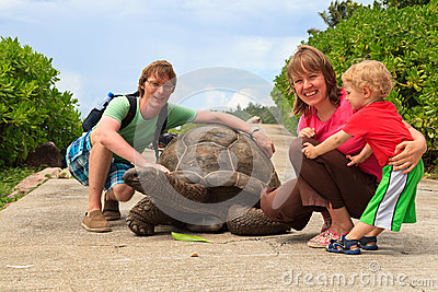 Family with giant turtle