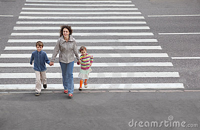 Family is going to cross road