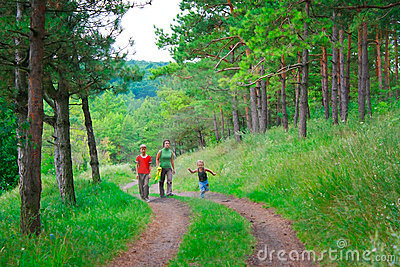 Family in the green forest for a walk