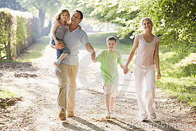 Family hands holding outdoors smiling walking