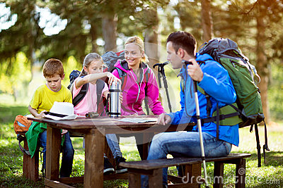 Family have a break from hiking Stock Photo