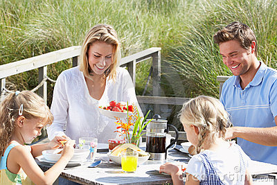 Family having breakfast outdoors on vacation