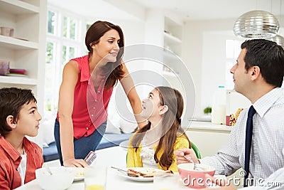 Family Having Breakfast Before Work
