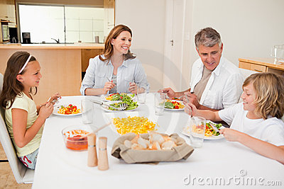 Family having a conversation while dinner