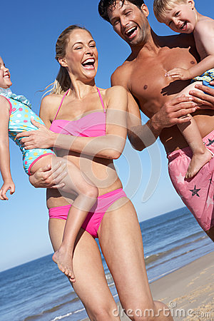 Family Having Fun On Beach