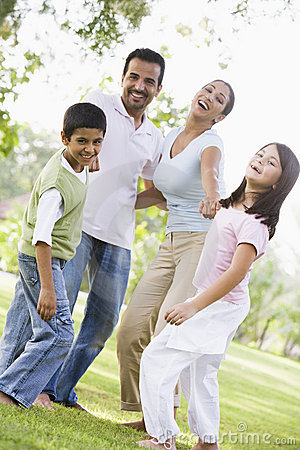 Free Family Having Fun In Park Stock Image - 5209461