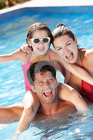 Free Family Having Fun In Swimming Pool Royalty Free Stock Photography - 27706207