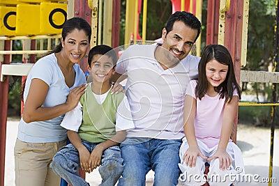 Family having fun in playground
