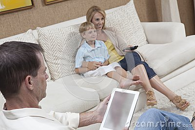 Family Having Leisure Time At Home