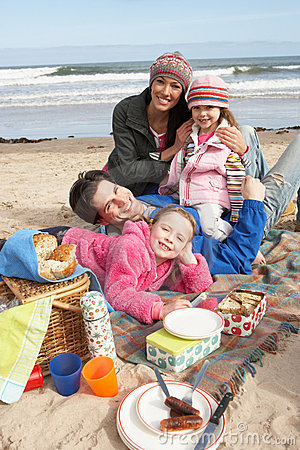 Free Family Having Picnic On Winter Beach Royalty Free Stock Photos - 16136878