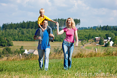 Family having walk on meadow