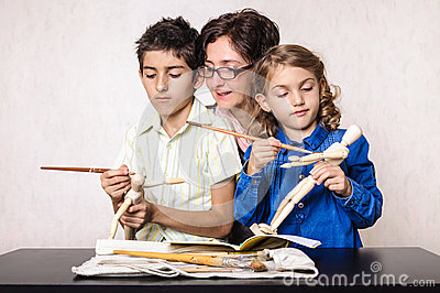 Family hobby mother boy and girl painting