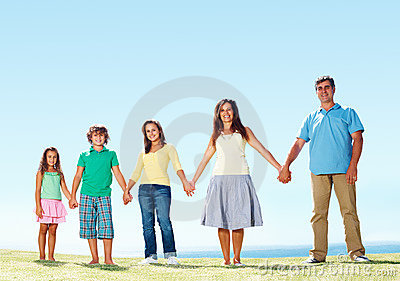 Family holding hands and standing in row
