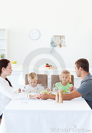 Free Family Holding Their Hands While Praying Stock Image - 17171011