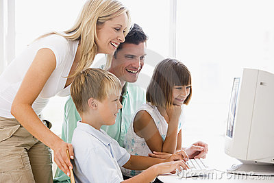 Family in home office using computer