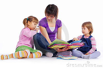 Family at home reading book