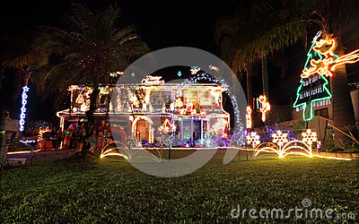 Family house decorated with Christmas lights and decorations Editorial Photo