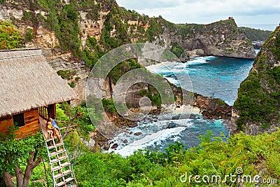 Family in house on tree at Atuh beach, Nusa Penida Stock Photo
