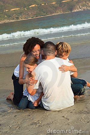Free Family Hugging On The Beach Royalty Free Stock Images - 9373749
