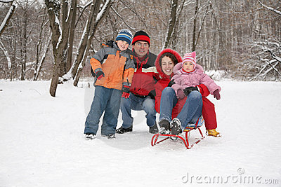 Family inforest at winter