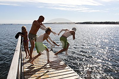 Family jump into the sea on summer in Denmark Editorial Image