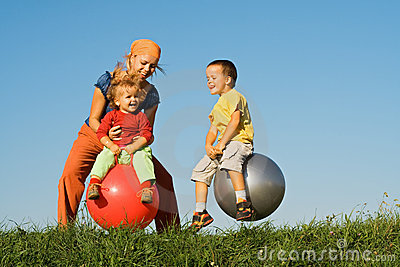 Family jumping on grass