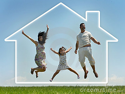 Family jumping with home in the clouds