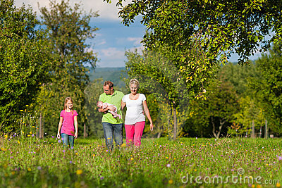 Family with kid having walk in summer