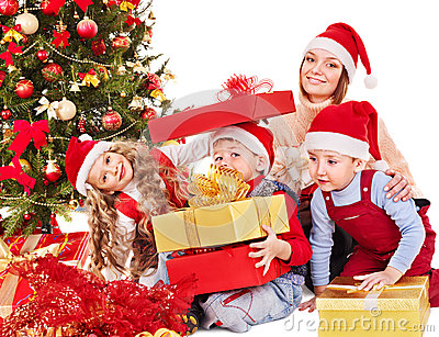 Family with kids open Christmas gift box.