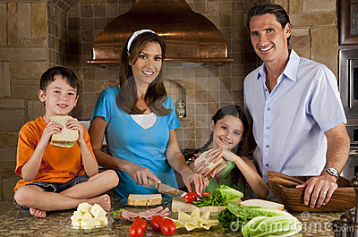 Family In Kitchen Making Healthy Sandwiches
