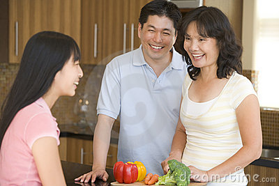 Family Laughing While Preparing Meal