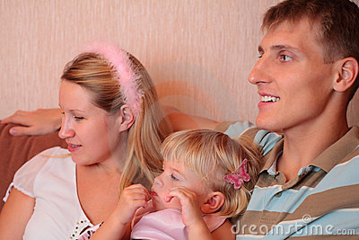 Family with little girl in room