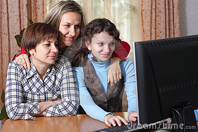 Family in living room with computer