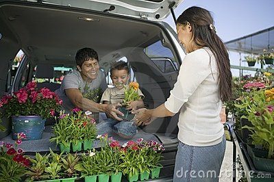 Family Loading Flowers into van