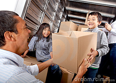 Family loading a truck