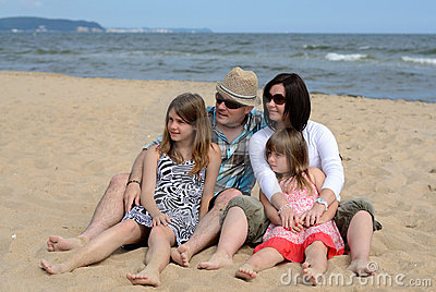 Family looking on the beach side