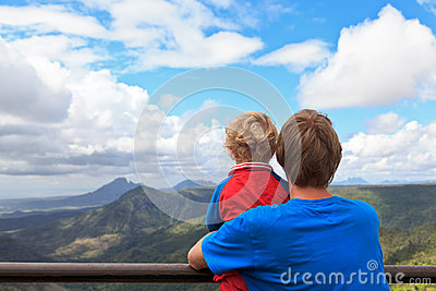 Family looking at mountains of Mauritius