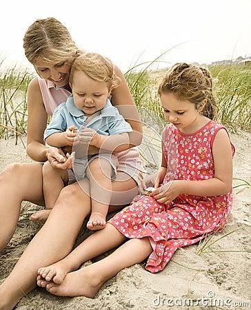 Family looking at shells
