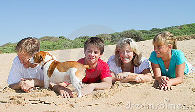 Family lying on beach