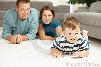 Family lying on carpet
